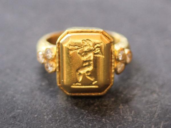 """Elizabeth Locke Octagonal Gold """"Cherub with Flute"""" Ring with Diamonds Triads model shot #3"""