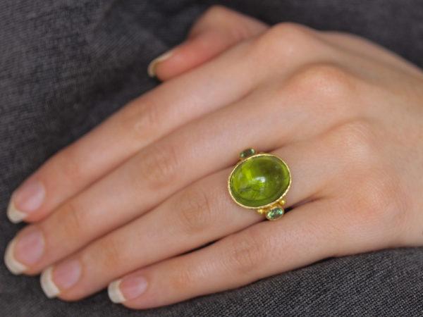Elizabeth Locke Oval Cabochon Peridot Ring with Side Demantoid Garnets